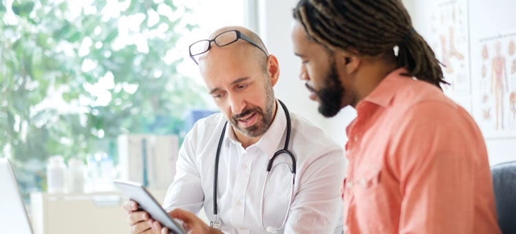 Doctor and patient reviewing a computer tablet